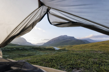 Scenic view of field and mountains seen from tent