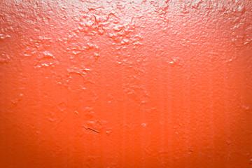 Painted red metal with dirt streaks