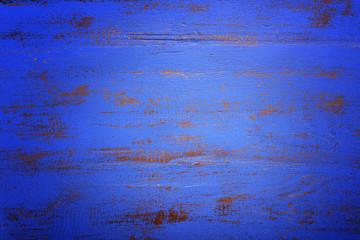 Dark blue rustic wood background, with applied dark vignette fil