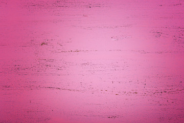 Pink rustic wood background, with applied dark vignette filters.