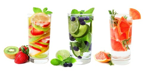 Three types of fruit infused water in glasses isolated on a white background