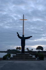 Religious Cross and Monument at Dawn