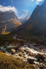 Mt .Machapuchare and waterfall ,Nepal.