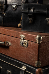 Close-up of a stack vintage shabby suitcases