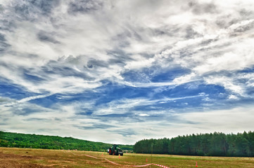Cherkasy, Ukraine - June 15, 2012: Large and powerful tractor German manufacturer Fendt, standing in a field
