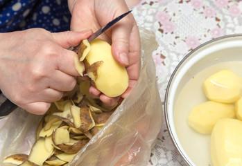 chef peeling potatoes