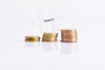 White missing puzzle and gold coins with travel, copyspace area