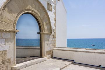 Mediterranean sea reflected in a window