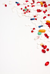 Heap of tablets and pills on white background. Copy space.