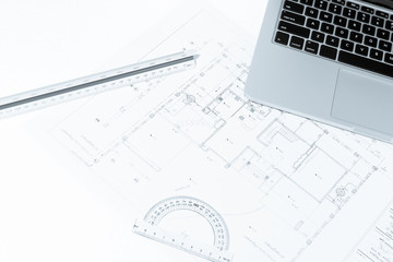 drawing rulers, and notebook over house construction blueprint w
