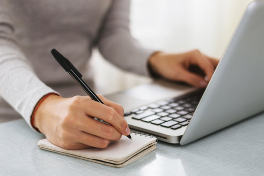 Businesswoman hand working with new modern computer and writing