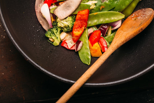 Cooking Asian wok with stir fry chicken and vegetables Chinese food Top view