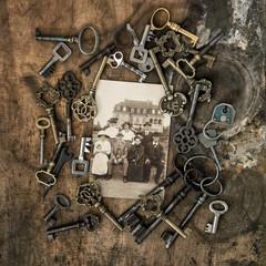 Vintage photo family portrait house Old keys