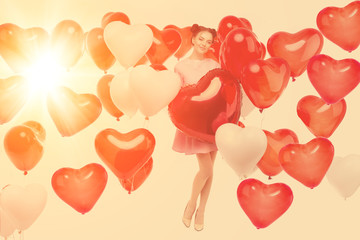 Beautiful girl, stylish fashion model with balloons in the shape