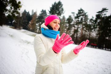 The young nice woman rejoices to winter walk.