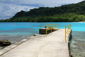 Cement pier-yellow metal railing. Champagne Beach-Espiritu Santo island-Vanuatu. 7379