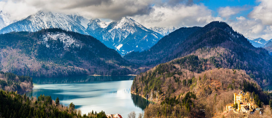 Panoramic view of scenic idyllic winter landscape in the Bavarian Alps at famous mountain lake Alpsee, Fussen, Allgau, Upper Bavaria, Germany