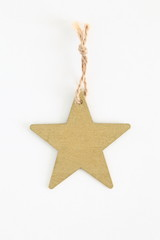 Red wooden star shaped tag with rope isolated on white