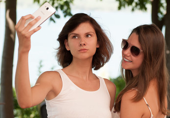 Two young girls posing for a selfie
