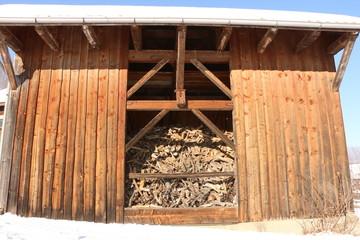 Barn with firewood, Scheune mit Brennholzvorrat