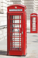 Two Vintage Red London Telephone Booths.