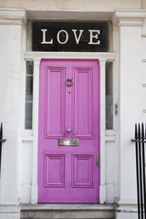 Pink door with letters 'LOVE' found on a house in Chelsea, London, United Kingdom.