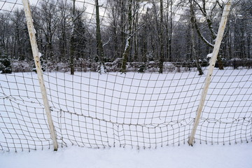 mesh gate football in city Park in winter