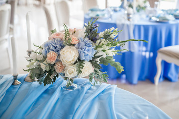 Wedding decor, table setting, floral arrangements in the restaurant