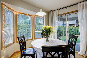 Dining room with curved window wall