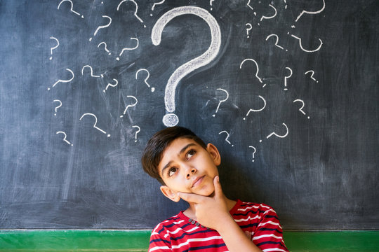 Doubts And Question Marks With Child Thinking At School