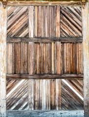 Grunge barn wooden gates closeup.