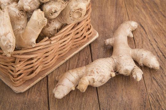 Ginger roots on wooden background (Zingiber officinale)