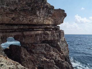 Rock formation at the cliffs of Mallorca with the sea in the background