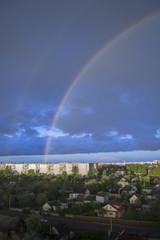 Double Rainbow over high-rise buildings near the slums
