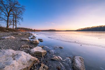 Sunset at the lake, rocks, ice, blue