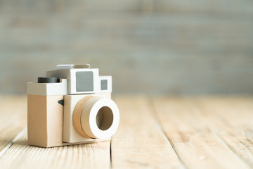 Camera paper on the wood background
