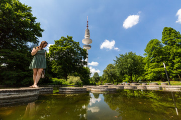 Girl in the front of the Heinrich Hertz Tower in Hamburg