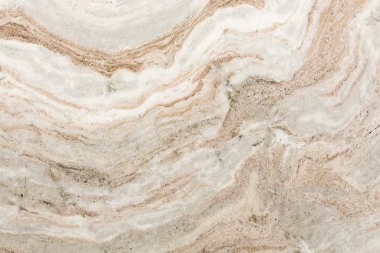 Beige quartzite stone texture close up.