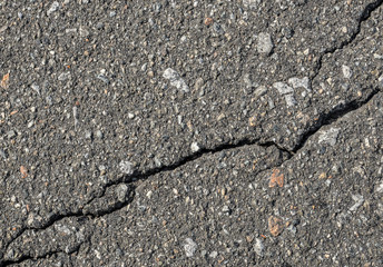 Asphalt with crack background. Old gray road for background or texture. Asphalt as abstract background or backdrop