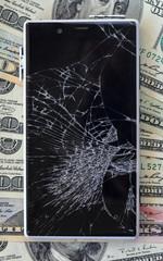 Smartphone with broken display on money background