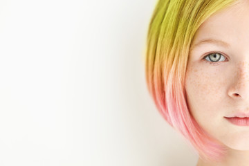 Trendy hairstyle concept. Girl with colorful dyed hair on white background