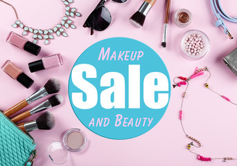 Makeup and beauty sale concept. Cosmetics and accessories on pink background