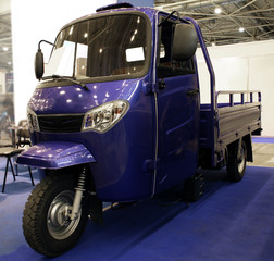 Three wheels car on automobile exhibition