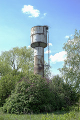 steel water tower green trees