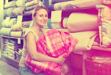 woman customer picking blanket .