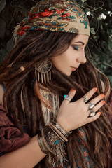 close up of gypsy style woman outdoors