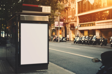 City bus stop with empty mock up banner for your advertising, blank billboard with copy space area for your text message or promotional content, public information board next to road