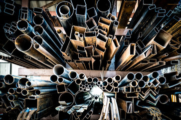Many type of old rustic  steel and iron. stack of steel pipes. selective focus.