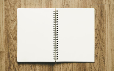 Blank spiral notepad notebook, on wood backgrounds