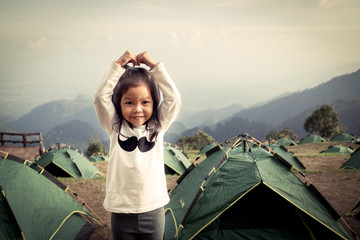 Cute litte asian girl having fun in the camp